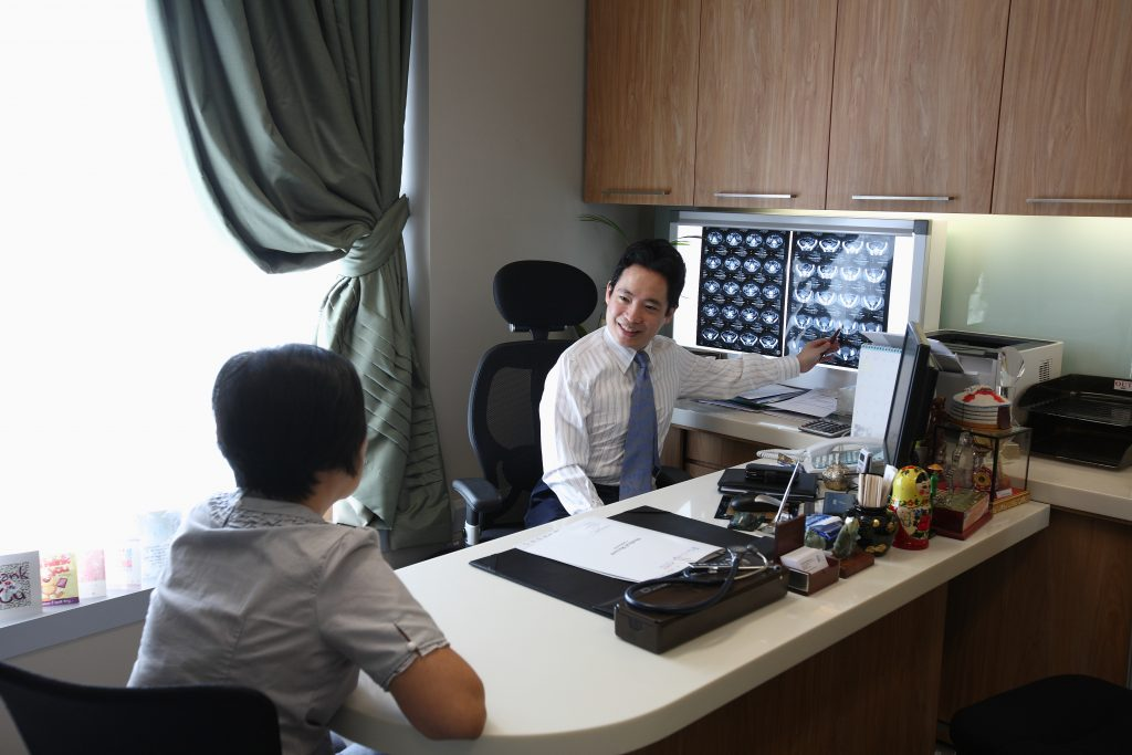 Dr Wong Seng Weng consulting a patient at The Cancer Centre