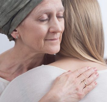 Woman hugging a cancer patient The Cancer Centre